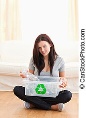 Gorgeous woman with a recycling box