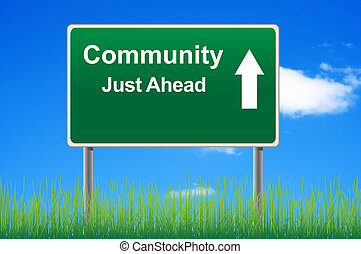 Community road sign on sky background, grass underneath.