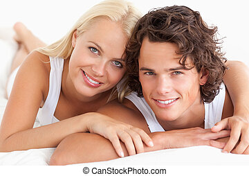 Couple lying on their bed in the bedroom