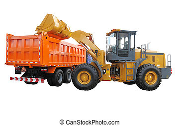 tractor-loader loads the truck - The image of wheel...