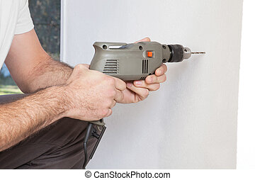 Human hand holding drill machine - Close-up of human hand...
