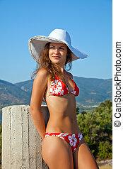 Young woman in red bikini