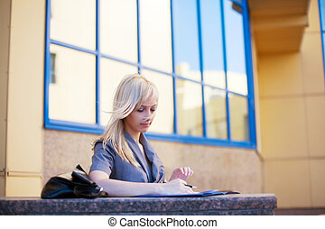 Young businesswoman working outside - Young businesswoman...