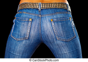 Female ass dressed in jeans on black