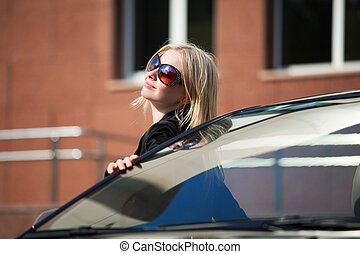 Young woman with a her car