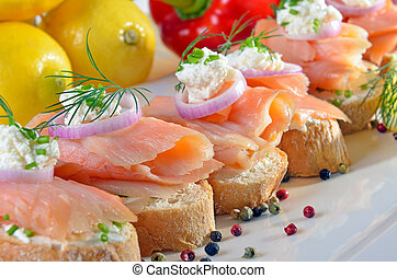 Finger-food with salmon - Baguette with smoked salmon,...