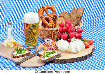 Bavarian snack plate - Wooden plate with radishes an a glass...