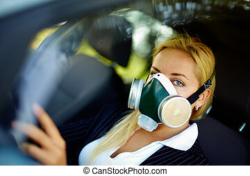 Protection - Photo of blond female breathing through...