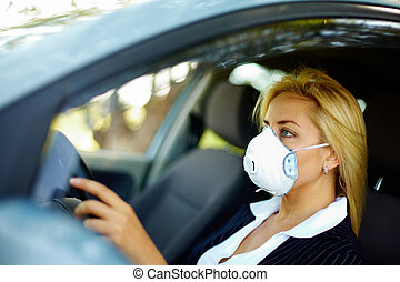 Driving in polluted zone - Photo of blond female wearing...