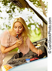 Woman with wrench - Photo of blond woman with wrench...