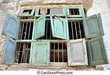 A cluster of eight broken dilapidated windows on an old...