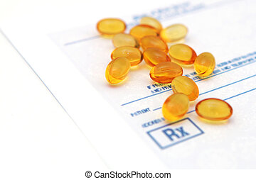 Oil vitamins yellow capsule on the