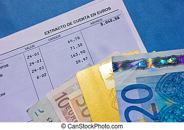 money and bank account - pile of euro baknotes with plastic...