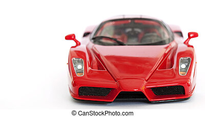 Red sport car miniature on white background