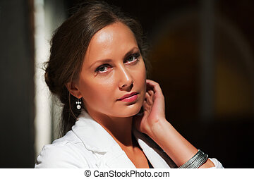 Young woman on a night street - Thoughtful young woman on...