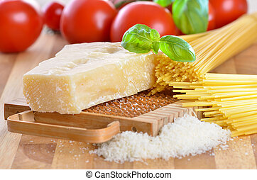 Italian parmesan cheese - Parmesan with a cheese grater,...