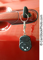 Car Key - Car key inserted into the car door lock
