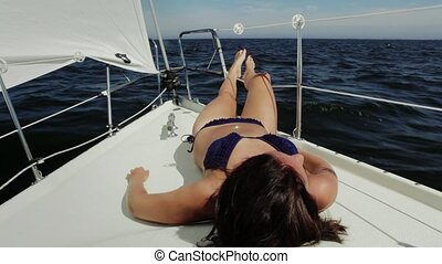 Sunbathing - Young woman enjoying the sun and the sea