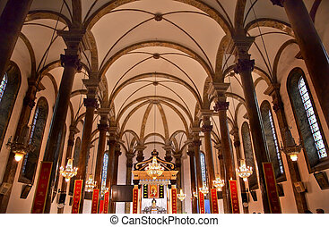 St. Joseph Wangfujing Cathedral, Basilica, Interior Church Beijing China.  Very famous Catholic Church built in 1655 and in Boxer Rebellion  Chinese Character signs are Christian sayings in Chinese