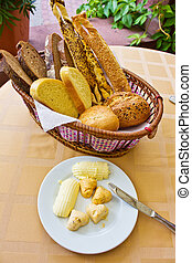 bread backet and butter plate - bread backet with plate of...