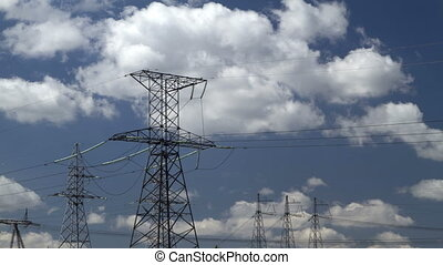high voltage power pylons. - wide angle view of high voltage...
