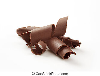 Chocolate curls on white background - closeup