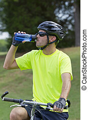 Mountain Biker - Male cyclist preparing to ride a mountain...