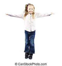Little girl jumping with arms out for camera - Little girl...