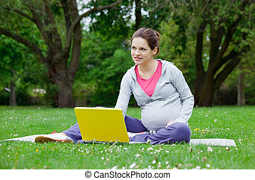 pregnant woman with laptop - Beautiful pregnant woman with...