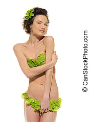 sexy woman with cabbage and green lettuce isolated in white