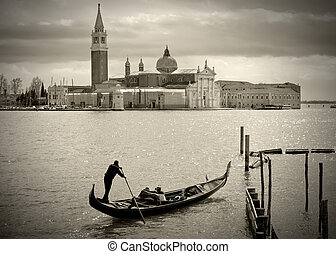Gondolier in Venice - Gondolier in front of San Giorgio...