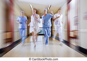 Surgeon and nurse running in hallway of hospital