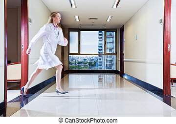 Female doctor rushing in hallway - Female doctor rushing...