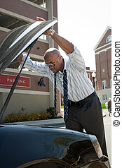 Business Man with Car Trouble - A business man having a bad...