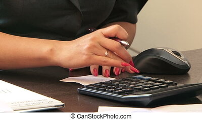 Calculate using a calculator - A girl counts using a...
