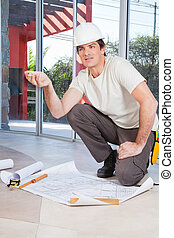 Construction worker with project paper
