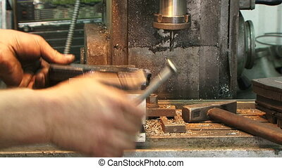 Industrial drill - The man with the help of industrial...