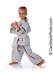 girl - karateka in kimono on a white background