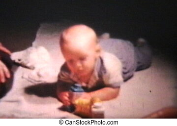 Baby Boy Plays With Toy Carrot 1962 - A cute baby boy plays...