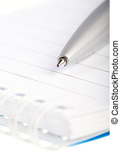 Notebook and ball pen on the white background, isolated