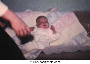 Baby Cuddled By His Mom 1962 - A loving mother gives her...