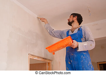 Apartment renovation - The working house painter paints a...
