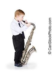 The boy plays a saxophone