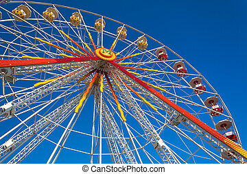 Ferris Wheel - A colorful ferris wheel against a deep blue...