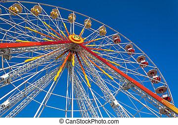 Ferris Wheel - A colorful ferris wheel against a deep blue...