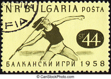 Javelin throwing on post stamp - BULGARIA - CIRCA 1958: A...