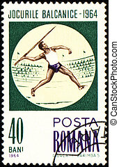 Javelin throwing on post stamp - ROMANIA - CIRCA 1964: A...