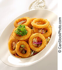 Onion Rings served on a bed of coleslaw salad and tartar...