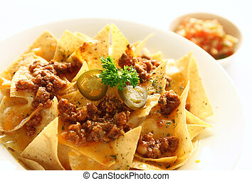 Mexican food appetizer - Nachos with melted cheese and salsa