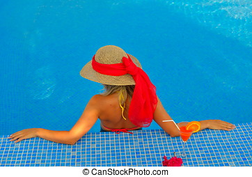 young woman relaxing at the pool - young woman relaxing at...